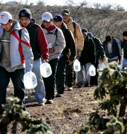 Illegal immigrants in a line